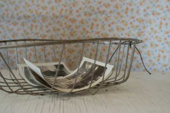 A wire basket and some old photos. The photos are for a project I have in mind.